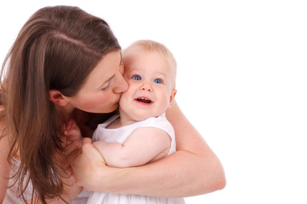 mother-kissing-baby